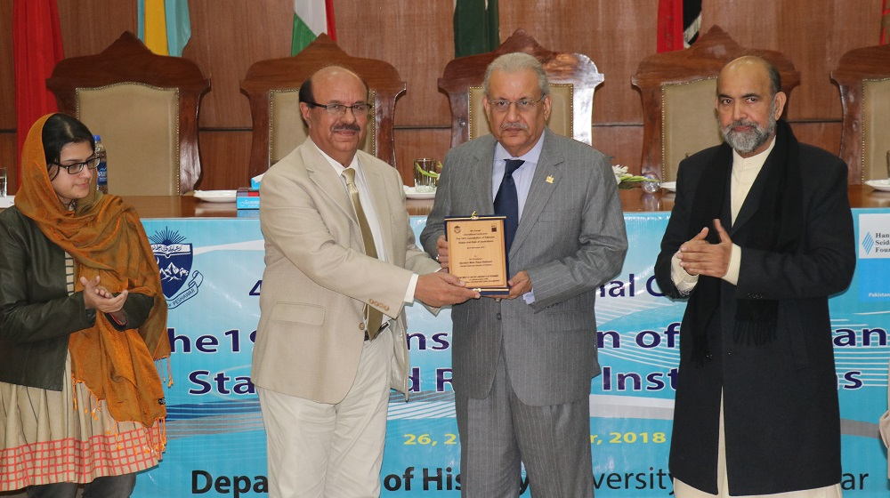 The Vice Chancellor University Of Peshawar Prof. Dr. Muhammad Asif Khan is giving shield to key note speaker Constitutional expert Senator Mian Raza Rabbani on the eve of two days international conference   organised by Department of History on 26th November, 2018.