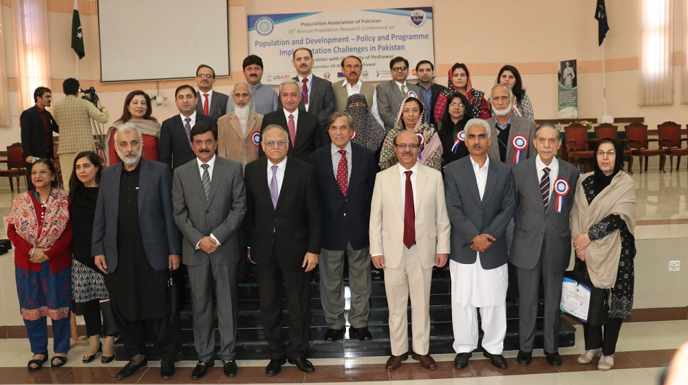 The Vice Chancellor University of Peshawar Prof. Dr. Muhammad Asif Khan is standing along luminaries at the inaugural session of two days international conference entitled as