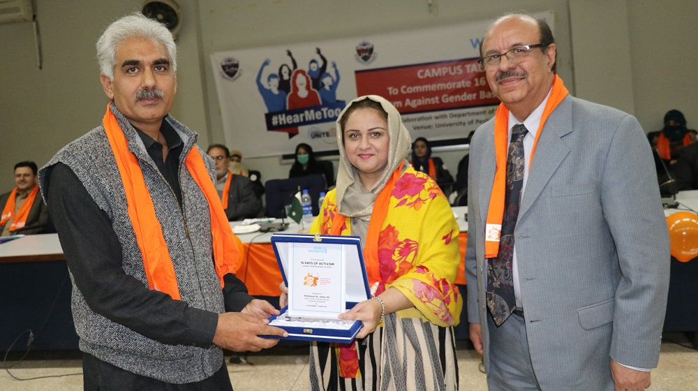 The Vice Chancellor University of Peshawar standing along UN-Women Khyber Pakhtunkhwa chief Zainab Qaiser khan is giving shield to Dean Social sciences Prof. Dr. Johar Ali on the occasion of 16 days activism against gender based Violence on 6th December, 2018 at SSAQ Hall.