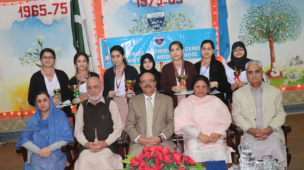 The Vice Chancellor University of Peshawar along with Chairman B.I.S.E Peshawar are posing with position holders of Matriculation of 2017 annual results on 12th December, 2018 in a grand function to honour students of 2017 and 2018.