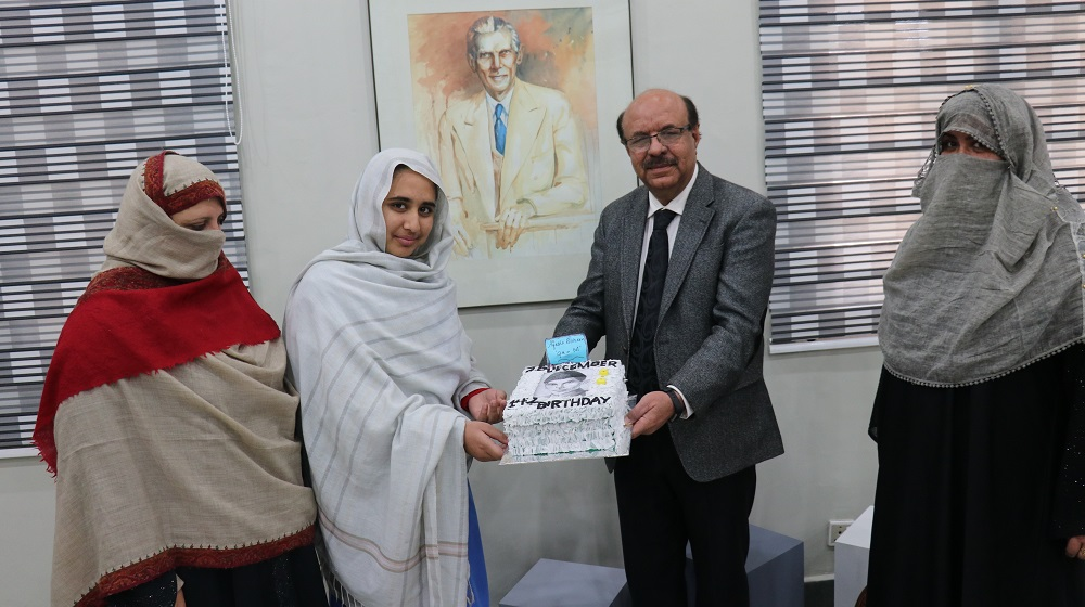 Ayesha Roheen, a student of class 9th at University Model School is presenting a souvenir cake to mark the 142nd birthday of father of the nation Quaid-e-Azam Muhammad Ali Jinnah to the worthy Vice Chancellor University of Peshawar Prof. Dr. Muhammad Asif Khan on tuesday 18th December, 2018.