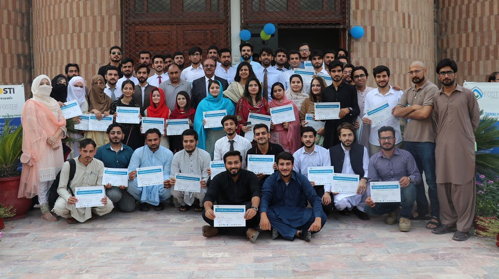 Vice Chancellor University of Peshawar is posing with the certificate holders of Foster learning two month intensive course on multi-communication & Entrepreneurship skills on 23rd September, 2019