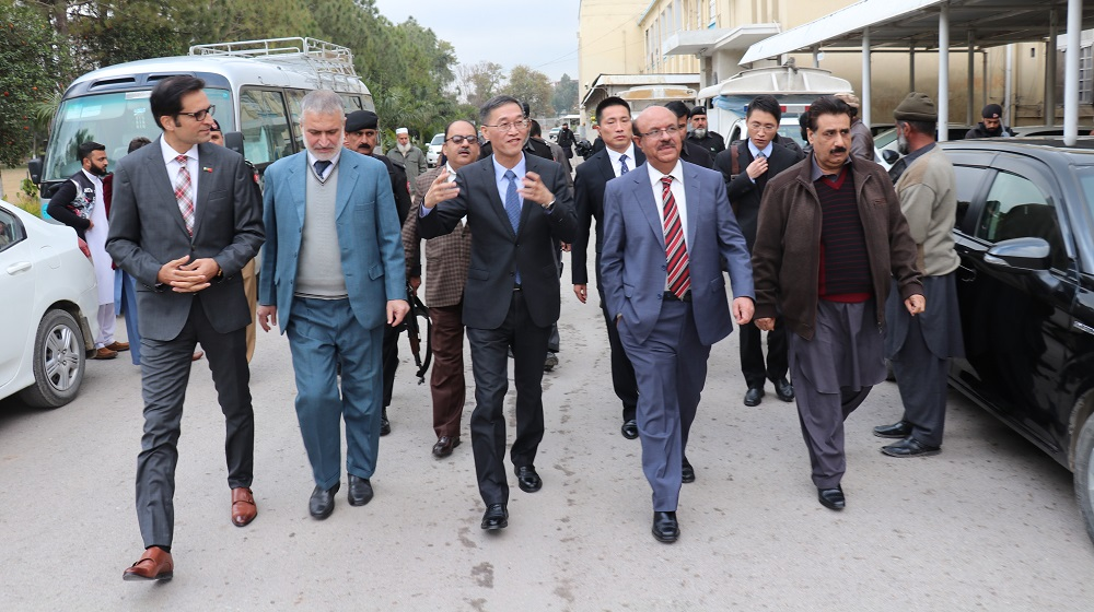The Vice Chancellor University of Peshawar along with His excellency Yao jing, Chinese ambassador to Pakistan is walking towards central library to handover 1600 books gift to University of Peshawar.