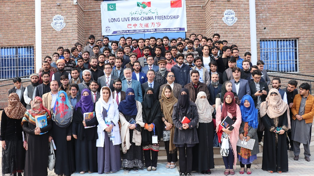 His Excellency Chinese ambassador to Pakistan  Yao Jing is posing for a group photo with Institute of Peace and Conflict Studies students and faculty at the facade of IPCS building on 22nd January, 2019.