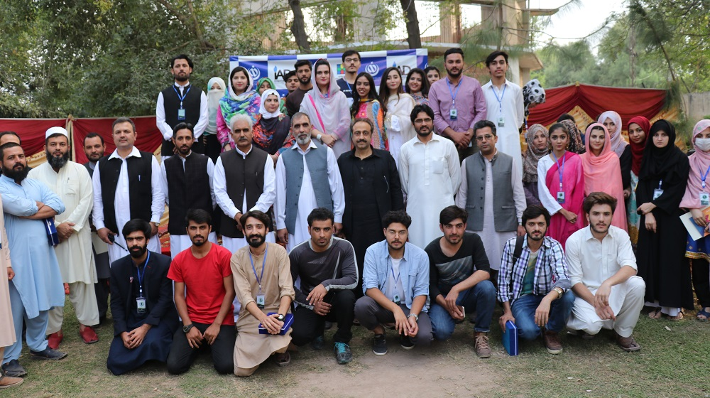 The Arts and Design Department students, faculty and alumni artists are posing for a group Photo with the acting Vice Chancellor Prof. Dr. Johar Ali on national arts day at the culmination of a three day exhibition, staged at the department four art galleries on 25th October, 2019.
