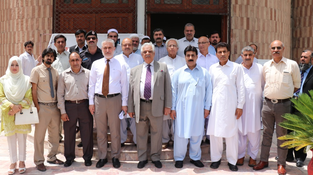 The Governor Khyber Pukhtunkhwa/ Chancellor University of Peshawar, Engr. Iqbal Zafar Jhagra pose for a group photo with faculty and exhibition organizers  after attending the international watercolour exhibition held at the SSAQ auditorium, university of Peshawar on Monday 14.05.2018
