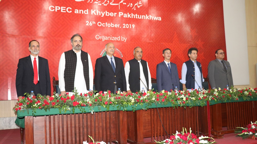 The worthy Governor/ Chancellor Khyber Pakhtunkhwa Universities Mr. Shah Farman  along with his Excellency Chinese Ambassador Mr. Yao Jing at a national seminar at the University of Peshawar stands together in respect of national anthem of China and Pakistan on 26th October, 2019.