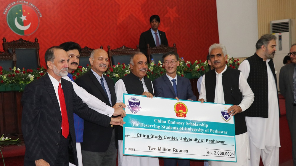 The acting Vice Chancellor Prof. Dr. Johar Ali is receiving the postcard signature Cheque of worth two million rupees for students scholarships already notified  during the national seminar at RAK auditorium, UoP  from the Chinese ambassador his Excellency Mr. Yao Jing on 26th October, 2019.