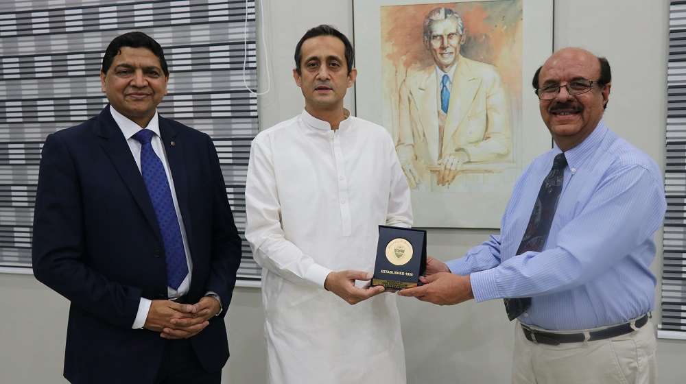 The Vice Chancellor University of Peshawar Prof. Dr. Muhammad Asif Khan is giving a souvenir  to the visiting  Secretary Higher Education Department  Zulfiqar Haider Khan