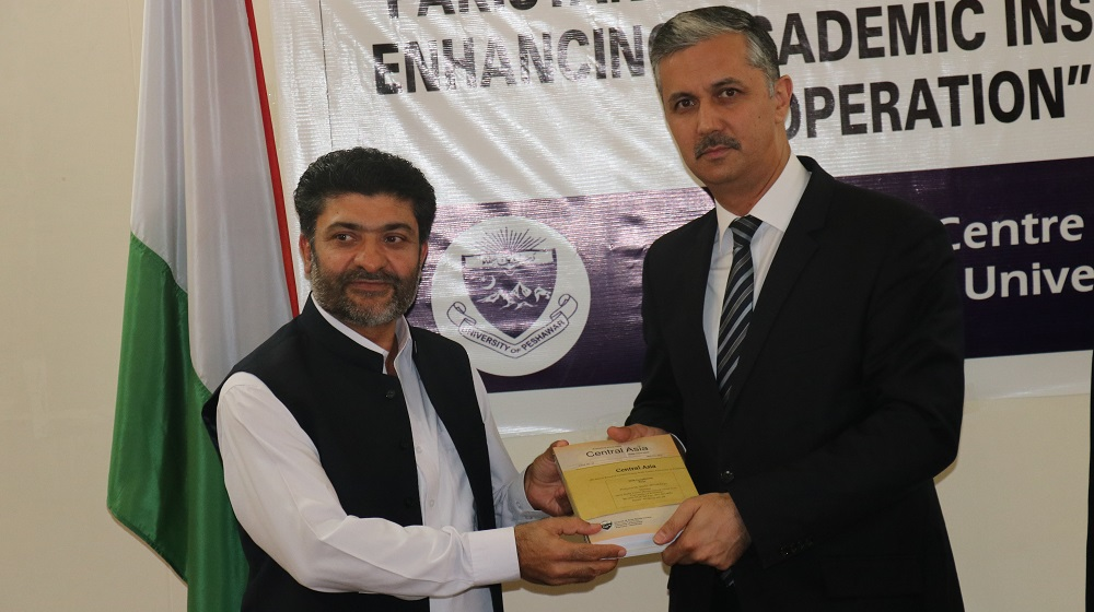 Director Area Study Centre Prof. Dr. Shabbir Ahmad Khan is presenting Central Asia Journals to His Excellency Mr. Ismatullo Nasredin, the ambassador of Tajikistan to Pakistan on his visit on 14th June.