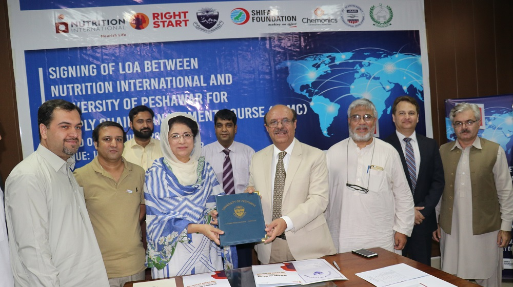 University of Peshawar and Nutrition International officials are posing for a group photo  after signing letter of agreement document at a ceremony at Committee Room #II on 4th July, 2019.