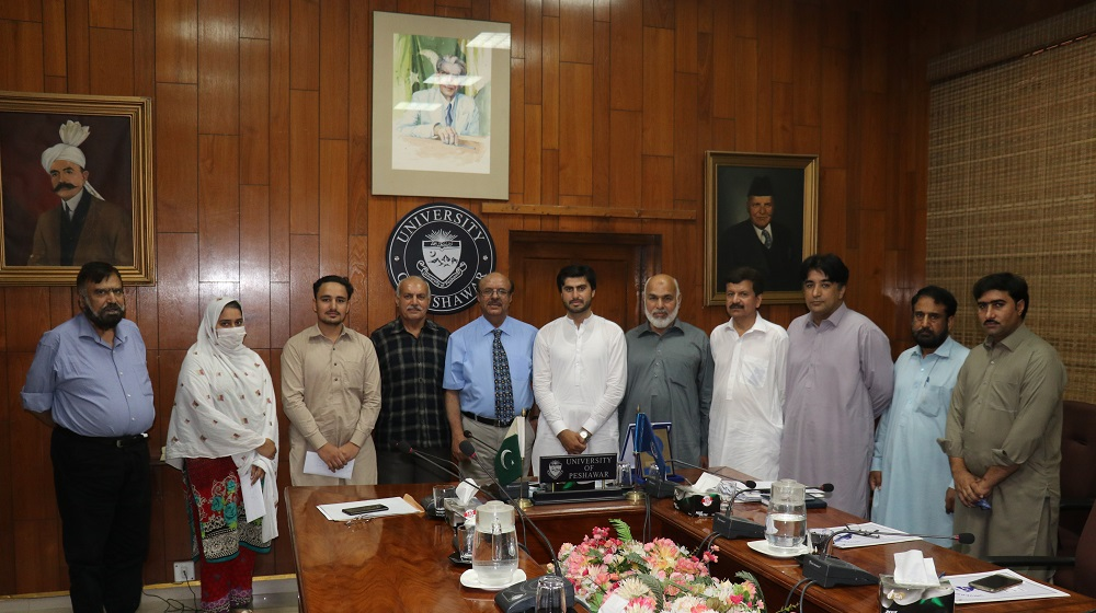 A group photo of the scholarships doling out ceremony being held at 11th July,2019 being patronized by Al-Mujtaba Education Trust and conducted by Student Financial Aid office of University of Peshawar.