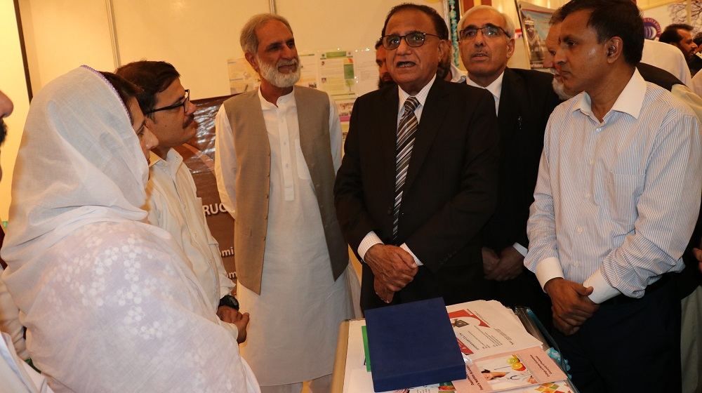 The Caretaker Chief Minister KP  Justice(retd.) Dost Muhammad Khan is expressing his excitement over University representation  at News Education Expo by Calling