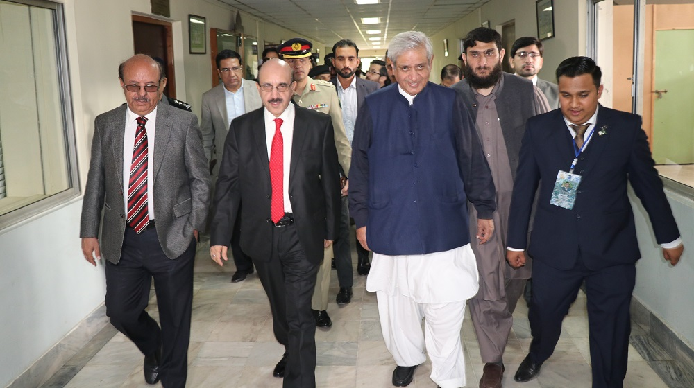 President AJK, Chairman Kashmir Committee and Vice Chancellor University of Peshawar are heading towards auditorium at the conference entitled