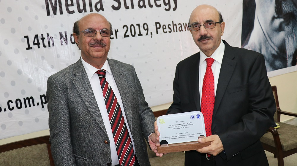 Vice Chancellor University of Peshawar Prof. Dr. Muhammad Asif Khan is handing over the shield to honour the chief guest, President Azad Jammu & Kashmir his excellency Mr. Masood Khan  during national conference at the University of Peshawar on 14th November, 2019.