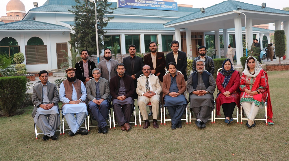 Vice Chancellor University of Peshawar Prof. Dr. Muhammad Asif Khan is posing for a group photo with the outgoing Peshawar University Teachers Association cabinet 2018-19 on 26th November, 2019.