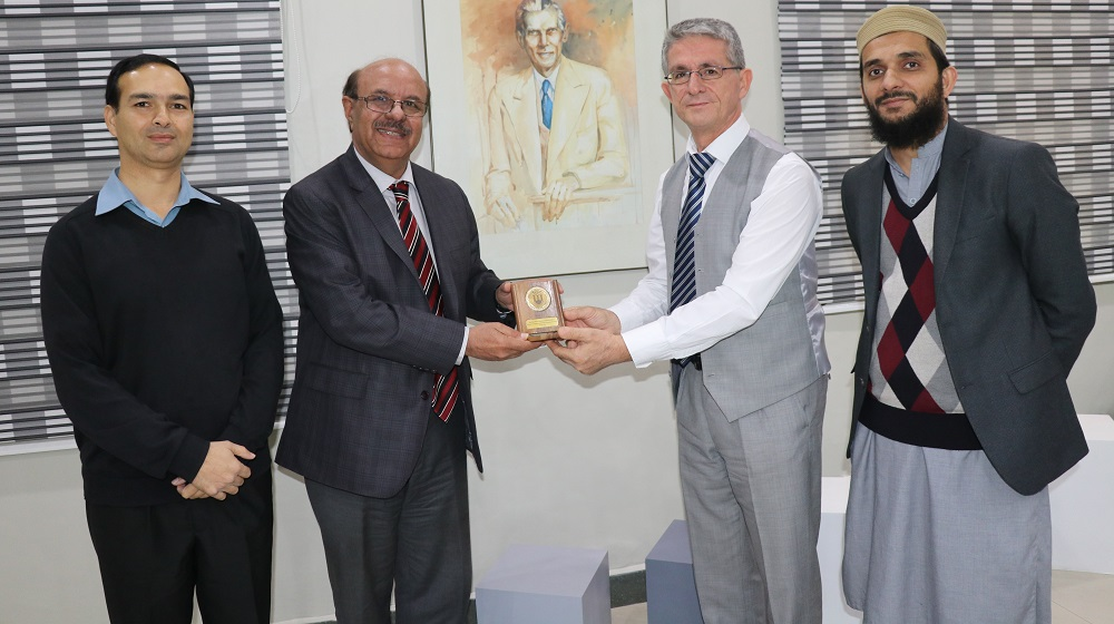 Turk professor Ilhan Tarimer from Mugla Sitki Kocman University, is presenting University souvenir to worthy Vice Chancellor Prof. Dr. Muhammad Asif Khan as a follow up of 'MoU'  with University of Peshawar on smart transport project  on 20th November, 2019.
