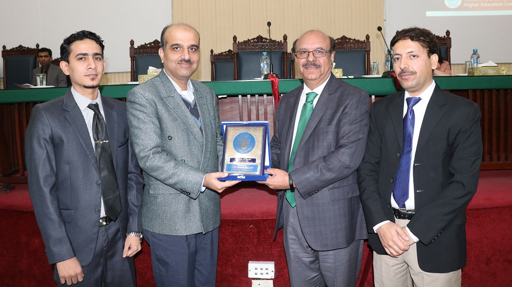 Vice Chancellor University of Peshawar Prof.Dr.Muhammad Asif Khan is handing over university souvenoir to Director Research and Development,HEC Zain Ul Abideen at the eve of road show on HEC annual research grants for public sector universities in HEC at RAK auditorium on 28 November, 2019.