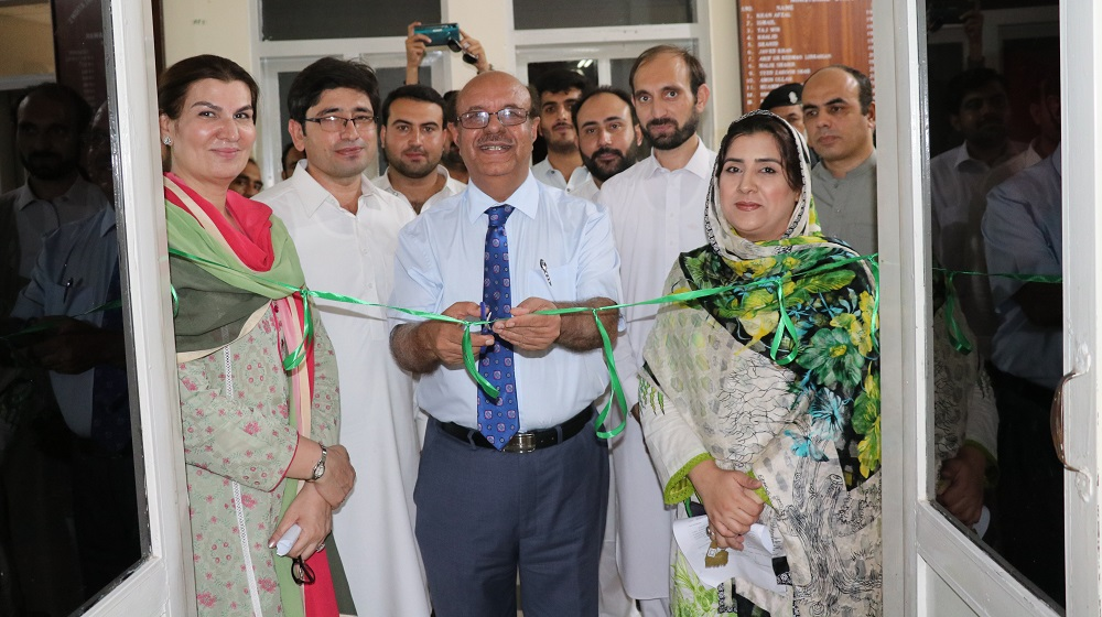 The Vice Chancellor University of Peshawar Prof. Dr. Muhammad Asif Khan is cutting the blue ribbon for 'R.M.Naib conference Hall' opening  at the Department of International relations.