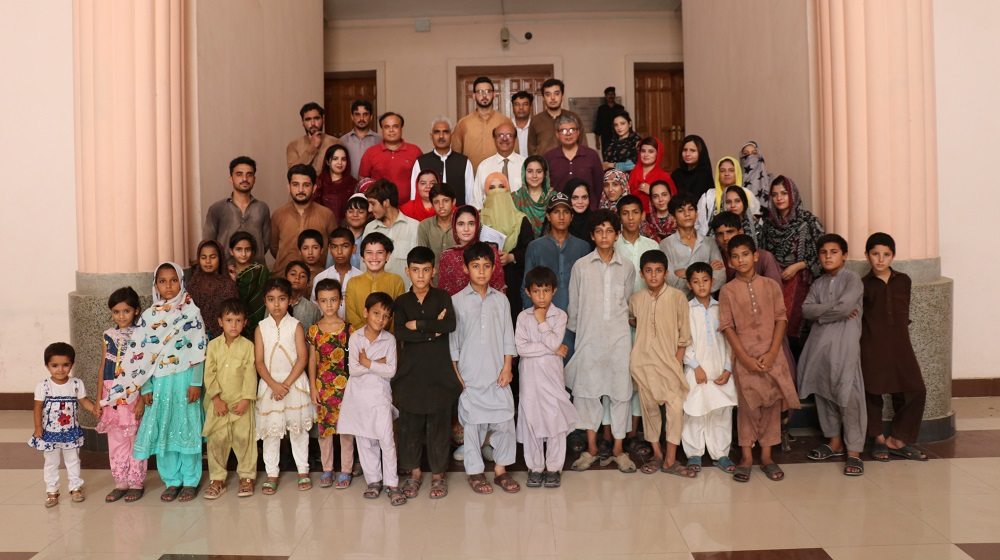 Street Children from district Peshawar are posing a group photo with Vice Chancellor University of Peshawar after undergoing a 45 days intensive training under the Community Service Program directorate initiative on 5th August ,2019/