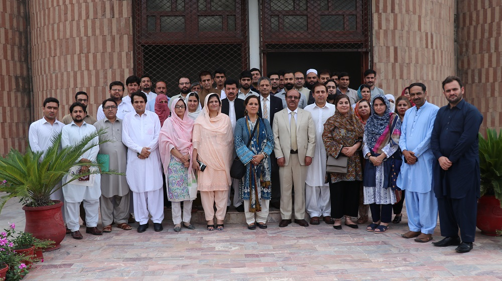 International Monetary Fund country representative Ms. Teresa Daban Sanchez is posing a group photo with Department of Economics faculty and academia on 7th August,2019 at SSAQ after a detailed talk on IMF' extended Fund facility.