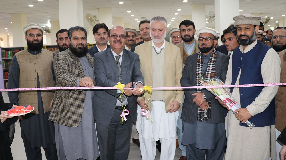 The Vice Chancellor University of Peshawar Prof.Dr.Muhammad Asif Khan is cutting the blue ribbon for first ever re-organized seminar library at academic block I in the wake of construction work at Central Library University of Peshawar on 9th December, 2019.