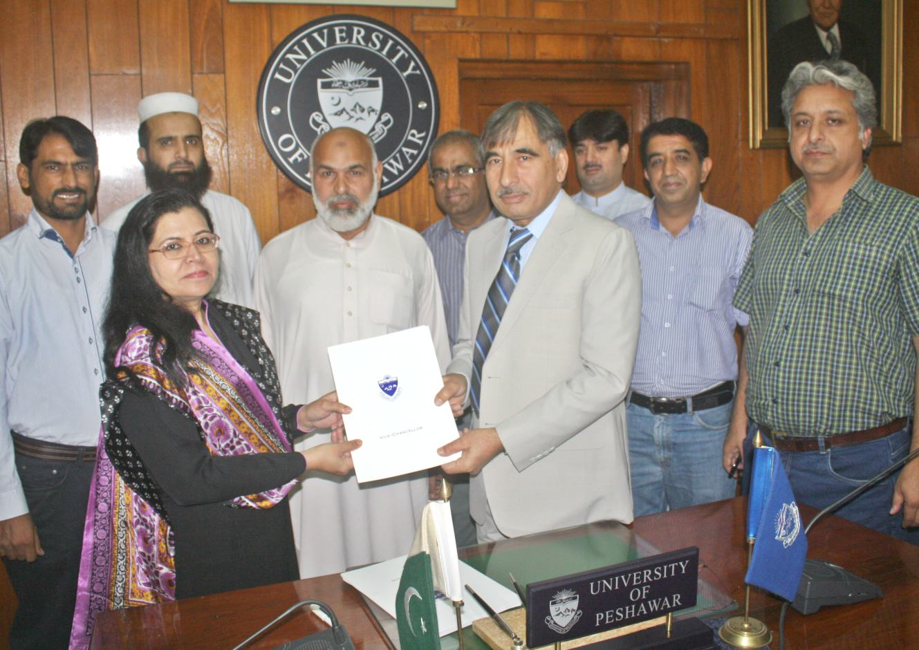 VC UoP Prof. Dr. Muhammad Rasul Jan and Country Programme Manager PLAN International Ms. Farrah Naz signing MoU at the UoP