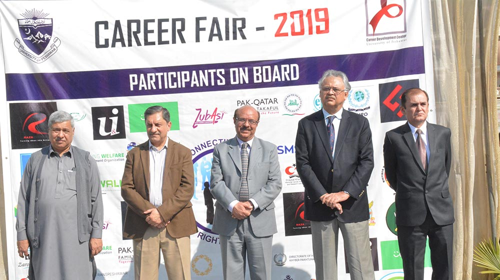 The First-ever Career Fair inaugural ceremony guests are standing to give a signature ovation  to the participating 40 local,national and international companies for sharing HR and career pathways for students of University of Peshawar on 06th March,2019.
