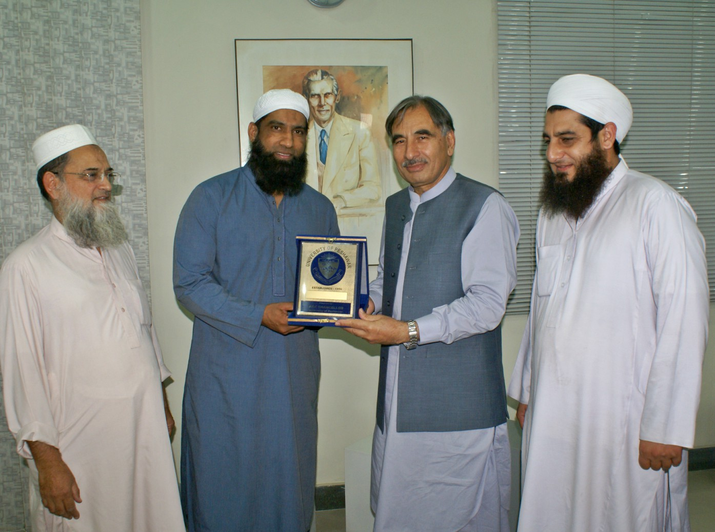 Vice Chancellor UoP Prof. Dr. Muhammad Rasul Jan presenting souvenir to former test cricketer Muhammad Yousaf during his visit to University of Peshawar