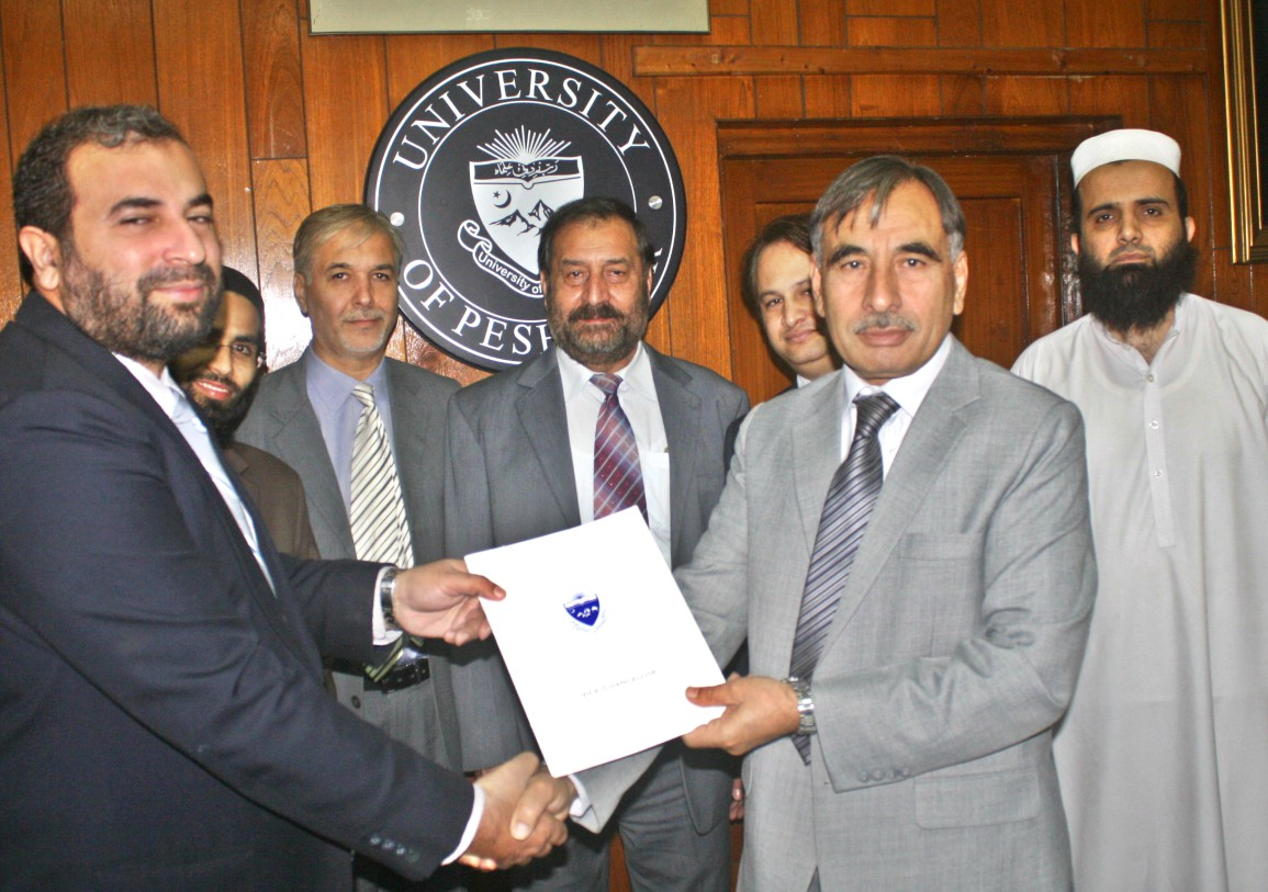Vice Chancellor UoP Prof. Dr. Muhammad Rasul Jan and representative of Meezan Bank signing MoU at the University of Peshawar