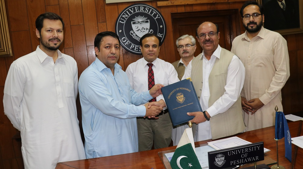 The Vice Chancellor University of Peshawar is sharing ' MOU' copy with Implementing partner of 'Cities for Children' for working for street children through Community services Program on 28th May, 2019.