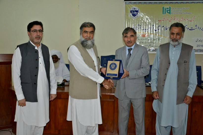 Vice Chancellor UoP Prof. Dr. Muhammad Rasul Jan presenting souvenir to VC Intl Islamic University Prof. Dr. Yasin Masoomzai at International Workshop on Interfaith harmony at the Baragali Camp University of Peshawar