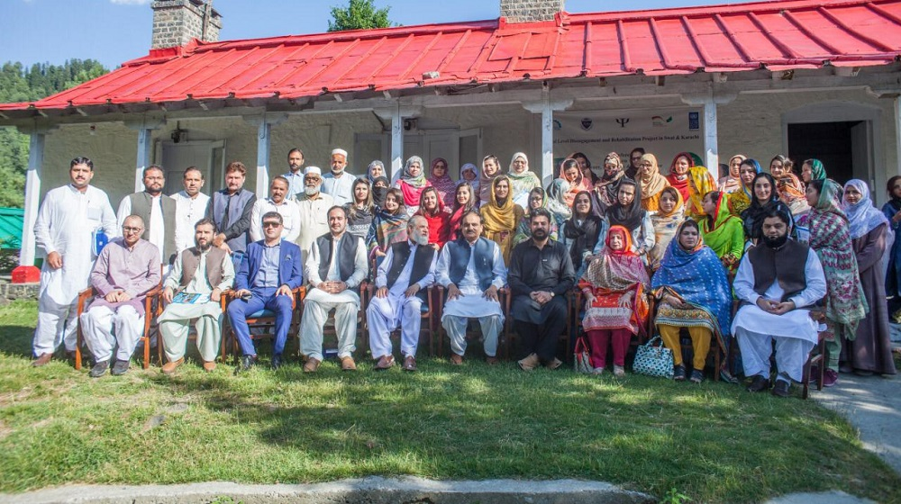 The Participants and speakers of a four day training workshop cum conference  aimed at meeting the academic and psychological challenges from 24-27 June,  at Baragali summer Campus are posing with District Nazim Swat Muhammad Ali Shah at the concluding session.