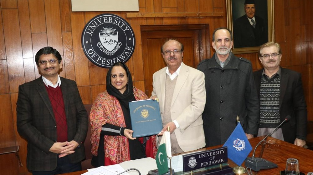 Vice Chancellor University of Peshawar Prof.Dr. Muhammad Asif Khan and Islamabad based BRICS-IPDS  president Ms.Farhat Asif are showing 'MoU' copy after signing ceremony to strengthen mutual academic and diplomatic relationships for research based activities on 8th January, 2020.