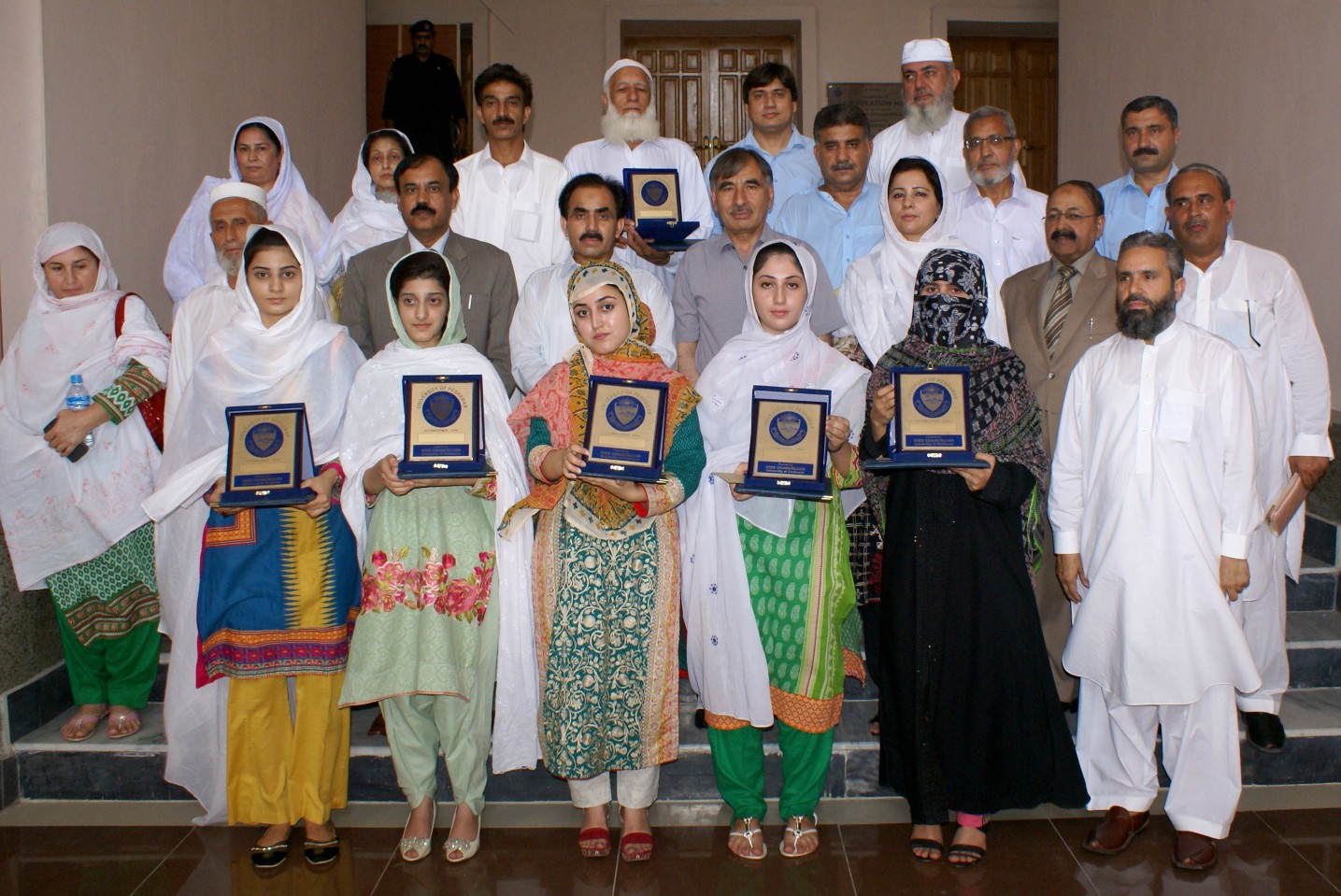 Vice Chancellor UoP Prof. Dr. Muhammad Rasul Jan in group photo with position holder students of BA, B. Sc result of the University of Peshawar