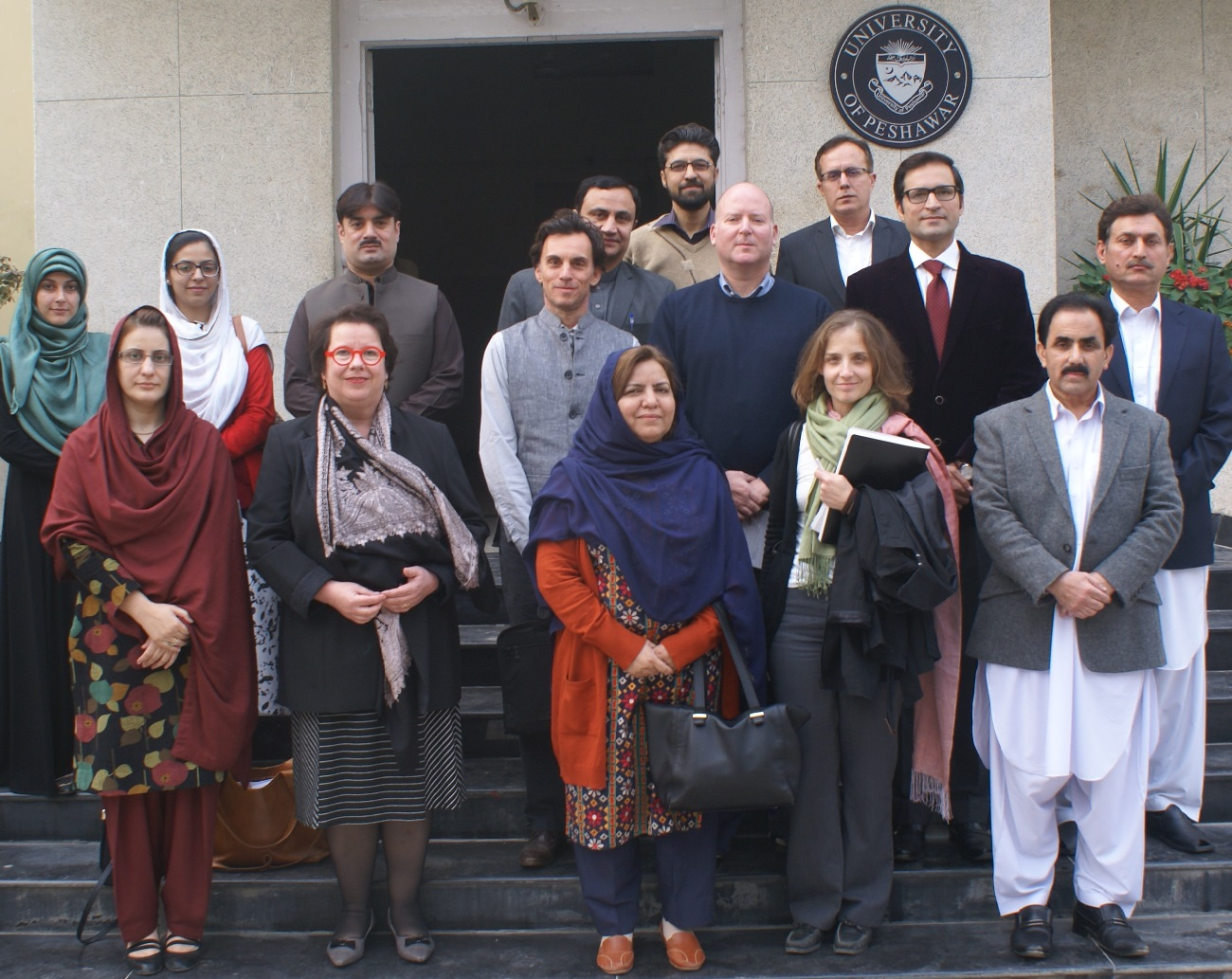 Registrar Dr. Syed Fazli Hadi in group photo with representatives Swiss Development Agency at the University of Peshawar