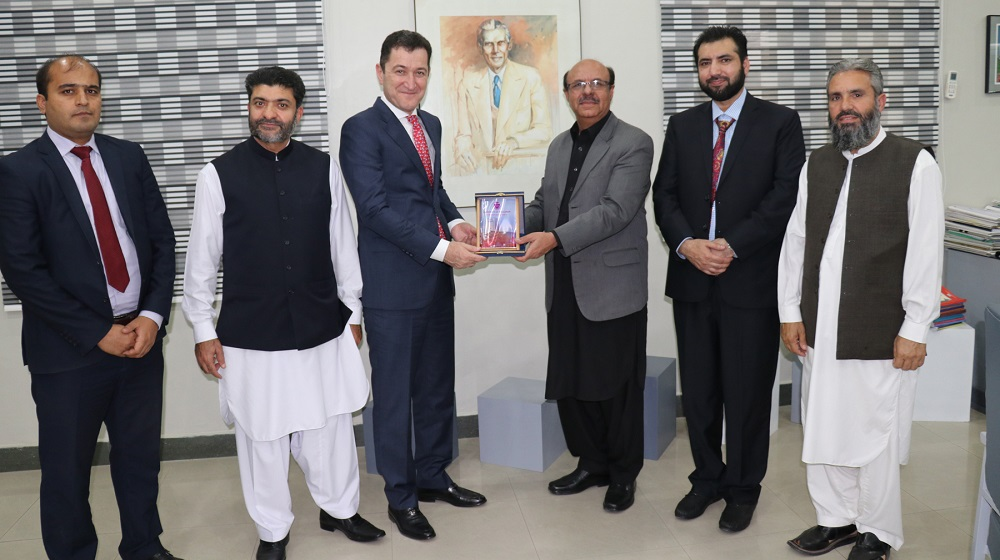 The Vice Chancellor University of Peshawar Prof. Dr. Muhammad Asif Khan is presenting a souvenir to visiting ambassador of Tajikistan in Pakistan His excellency Sher Ali Jananov for a talk at Area Study Centre on friday, 26th October, 2018.