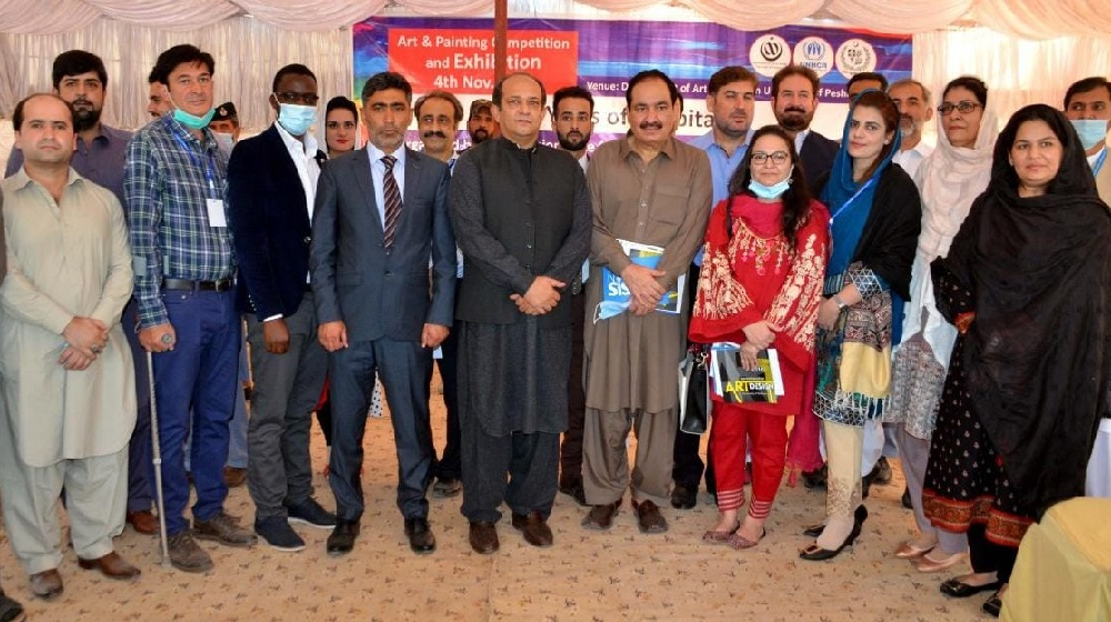 Afghan commissioner Muhammad Abbas Khan accompanying by Students and Faculty members during the Afghan Arts and Handicraft Exhibition at Department of Arts & Design, University of Peshawar organized with the collaboration of Commissionerate Afghan Refugees (CAR), KPK  and UNHCR.