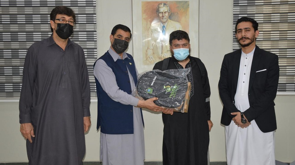 Vice Chancellor Prof Dr Muhammad Idrees starts distribution of laptops among special students while accompanied by Director Admission Ali Asghar Jan and Assistant Registrar Admission/ Focal Person for Prime Minister laptop scheme Mr Abdullah.