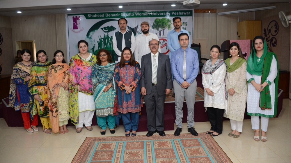 The Vice Chancellor University of Peshawar Prof.Dr.Muhammad Asif Khan is posing for a group photo with the Shaheed Benazir Bhutto Women University faculty  as a chief guest during Independence Day function on 22nd August, 2019.
