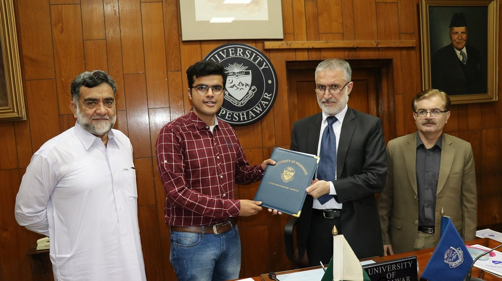 The Pro Vice Chancellor UoP Prof. Dr. Muhammad Abid is sharing MoUs documents with CEO Cykiq Hamza Afridi  to initiate short distance bicycling commute for students, teachers and residents for enabling congestion free, pollution free and Healthier Campus