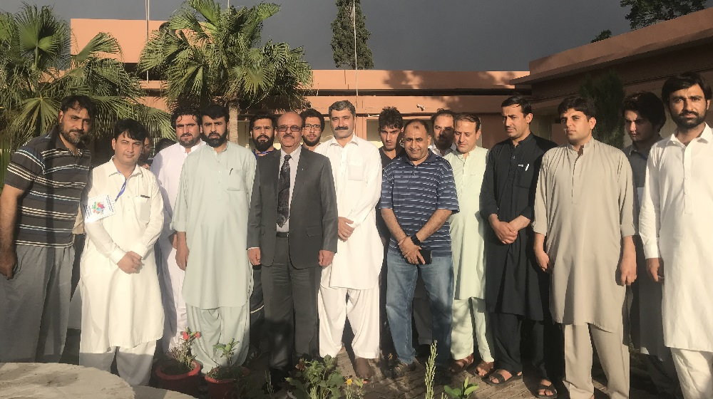 The Vice Chancellor University of Peshawar Prof. Dr. Muhammad Asif Khan posing for a group photo at the inaugural ceremony of Inter Hostel-Sports Gala 2018 with organizers on 2nd May,2018