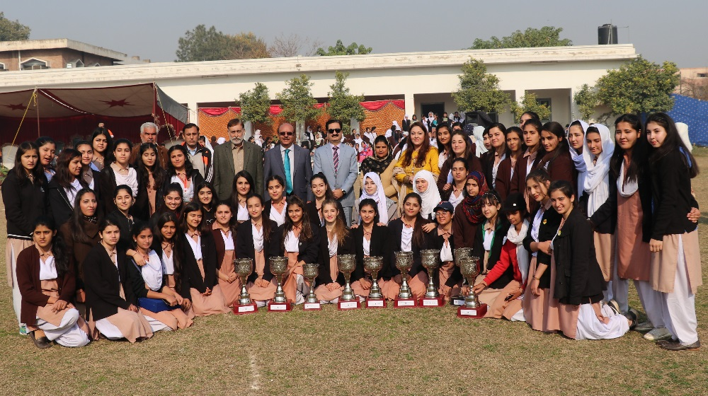 Vice Chancellor University of Peshawar along with former secretary Higher Education Department Mr.Manzoor Ahmad is taking a group photo with students during a ceremony for  Sports competition winners on 19th December, 2019 at Jinnah College for women.