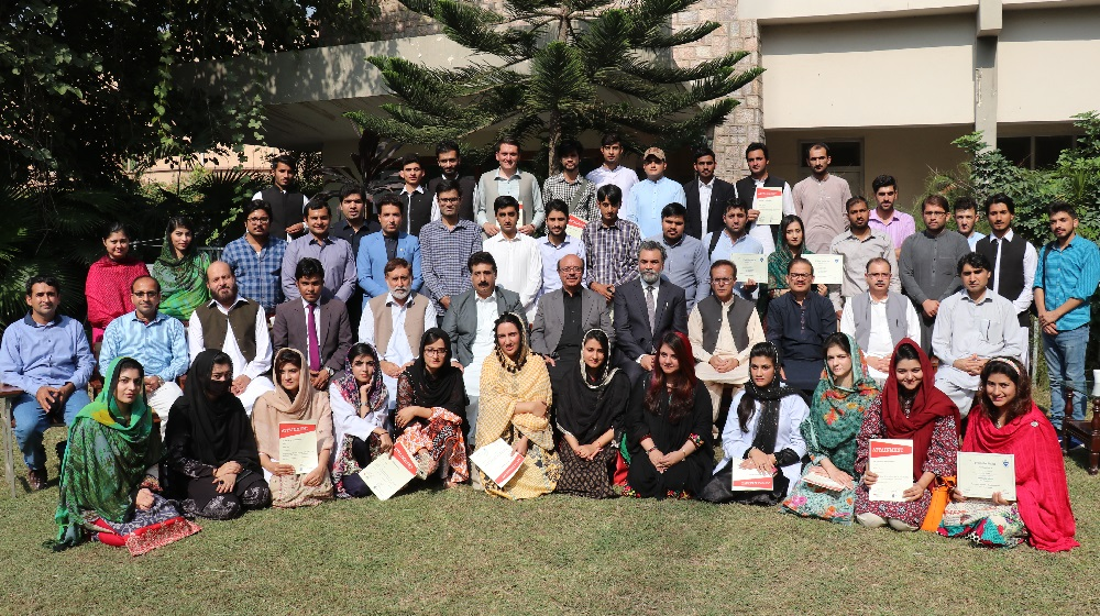 The VC UoP Prof. Dr. Muhammad Asif Khan is in a group photo with students and mid-career journalists who were given certificates at department of Journalism & Mass Communication, for courses in a joint venture between RMIT, Stanford, USIP and University of Peshawar on friday, 26th October, 2018.