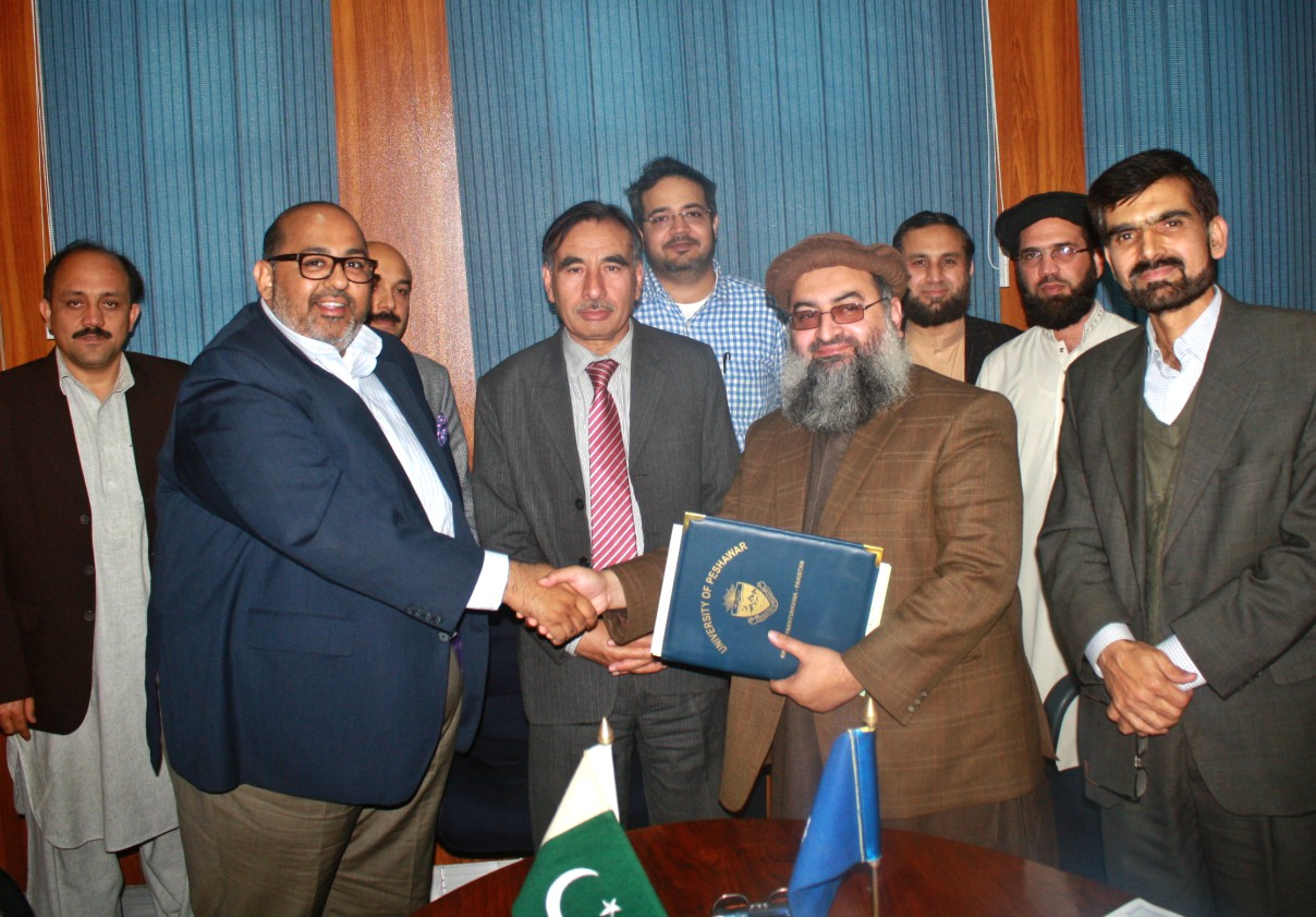 Vice Chancellor UoP Prof. Dr. Muhammad Rasul Jan and representative of inbox technology exchanging document after letter of agreement signed by both at the University of Peshawar