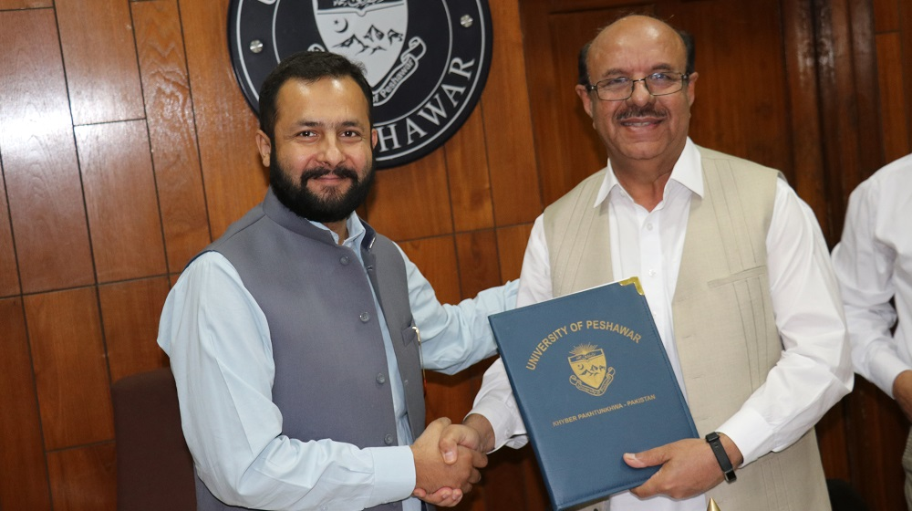 The Vice Chancellor University of Peshawar Prof.Dr. Muhammad Asif Khan  is sharing 'MoU' copy with Help Age international Program Manager Waqas Quershi to garner awareness activities and research sharing on Senior Citizens  plight on 28th May, 2019.
