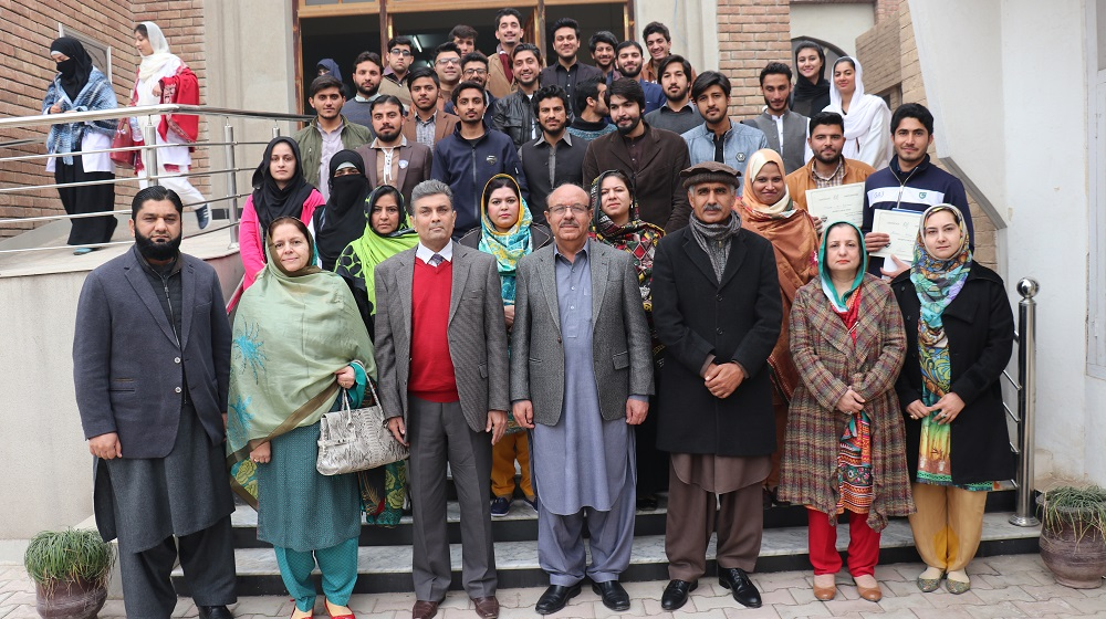 The Vice Chancellor University of Peshawar Prof. Dr. Muhammad Asif Khan is posing with the faculty members of Psychology department and winners of sports gala, while on a detailed visit on 18th January, 2019 at the Psychology department