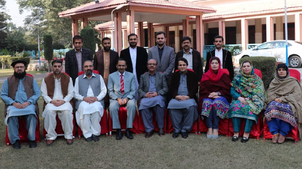 The Vice Chancellor University of Peshawar Prof.Dr.Muhammad Asif Khan  is posing with the outgoing PUTA cabinet 2017-18 at the Teachers Community Centre facade on friday,the 16th November,2018.