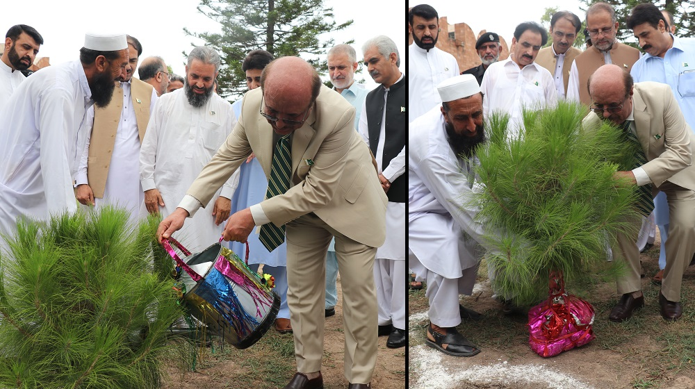 The Vice Chancellor University of Peshawar Prof. Dr. Muhammad Asif Khan is planting a tree at the adjacent lawn with SSAQ museum to commemorate the Independence Day celebrations