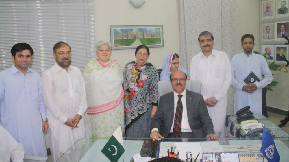 Prof. Dr. Muhammad Asif Khan in a group photo with the Faculty and Staff members at the occasion of Assumption of Charge Ceremony at UoP